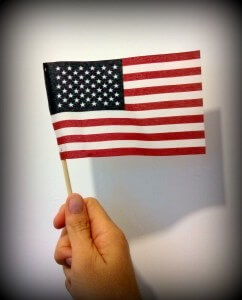 American flag in hand